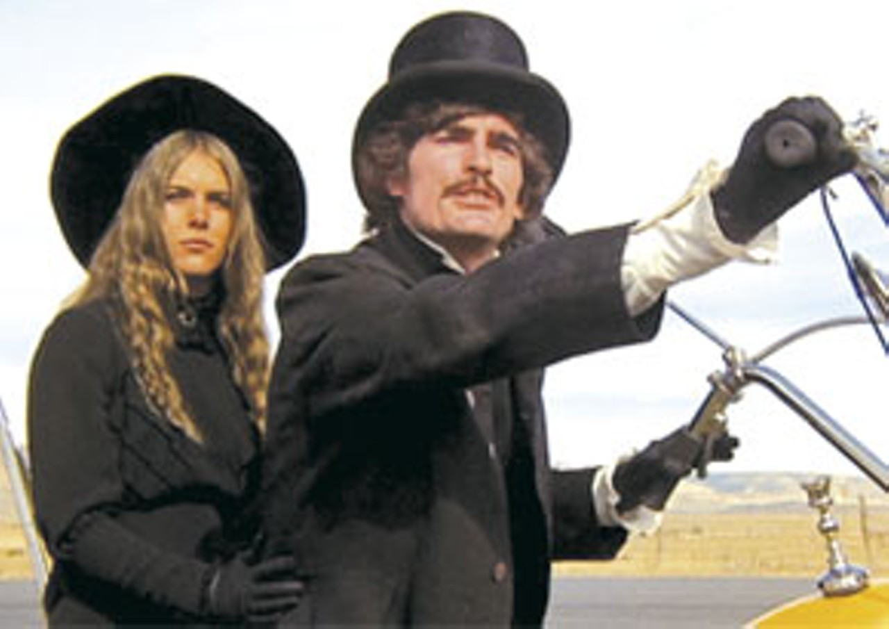 Edgar Allan Poe (Bruce Karcher) on a motorcycle accompanied by Eleanor in Gas; or It Became Necessary to Destroy the World in Order to Save It (1970)