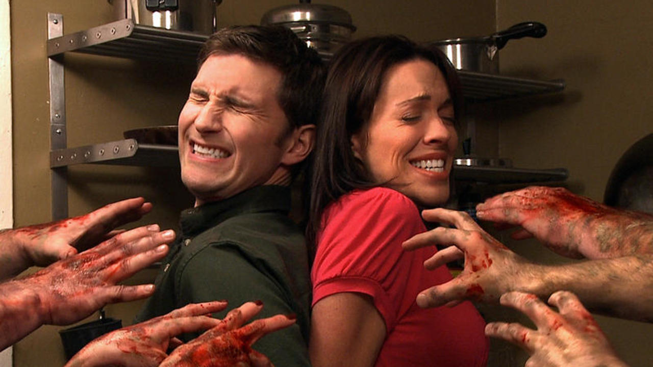 Peter Stickles and Michelle Tomlinson face zombies in George's Intervention (2009)