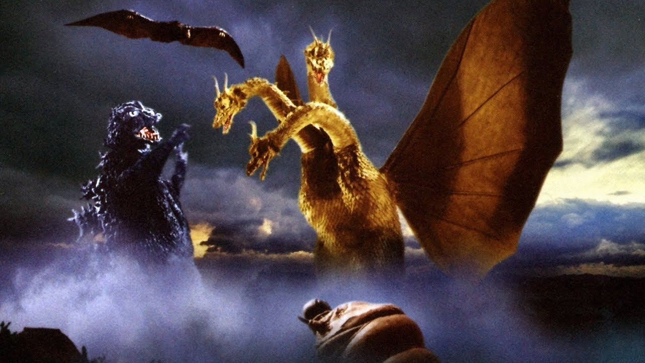 (l to r) Godzilla, Rodan (top) and the larval Mothra (bottom) battle Ghidrah (r) in Ghidrah the Three-Headed Monster (1964)