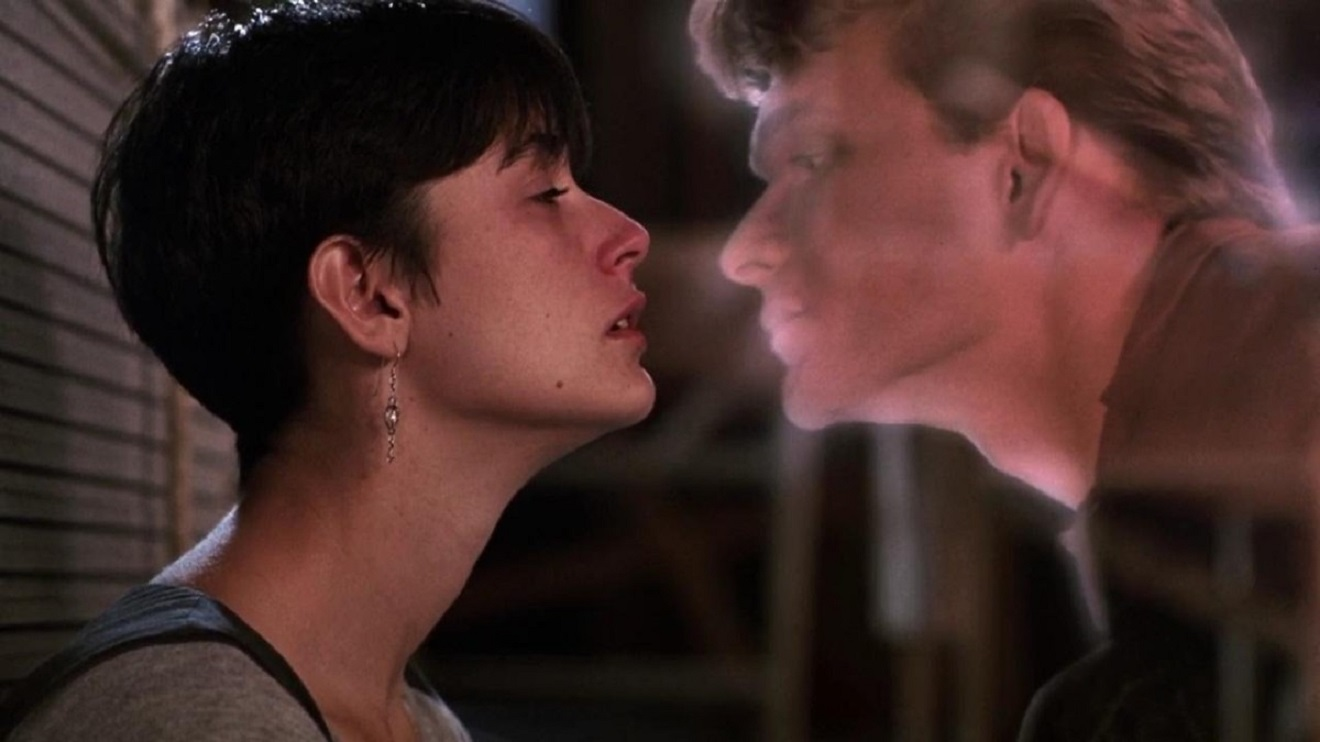 Demi Moore reaches out to kiss a ghostly Patrick Swayze in Ghost (1990)