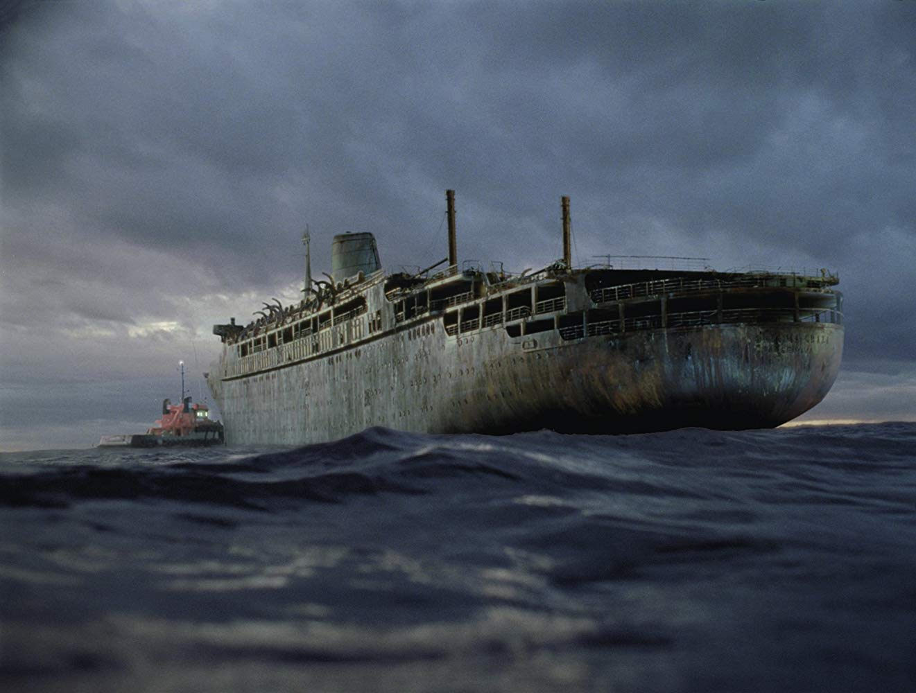 The tug Arctic Warrior approaches the ghost cruise liner Antonia Graza in Ghost Ship (2002)