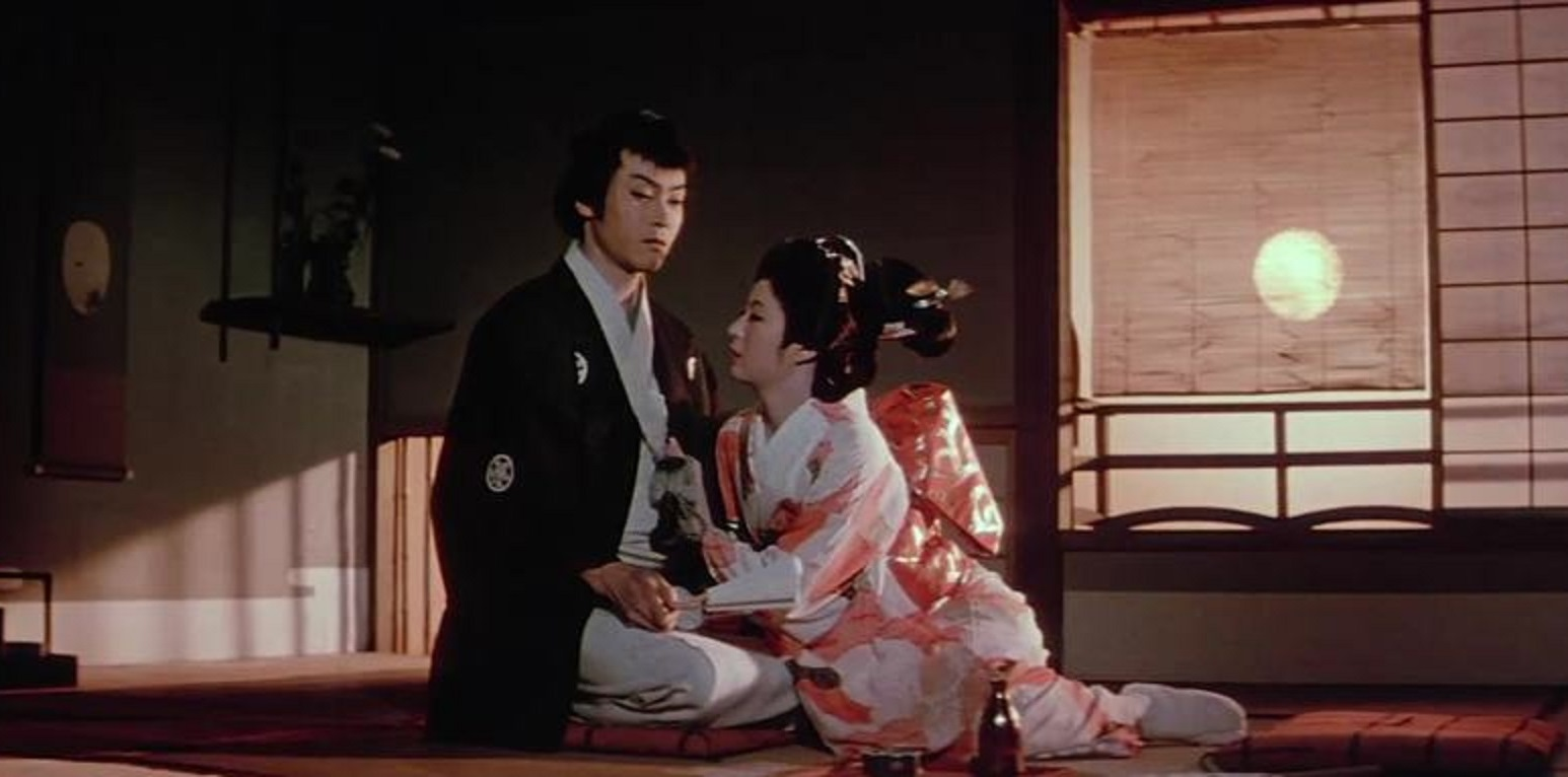 The samurai Iemon (Shigeru Amachi) and his wife Oiwa (Katsuko Wakasugi) in Ghost Story of Yotsuya (1959)