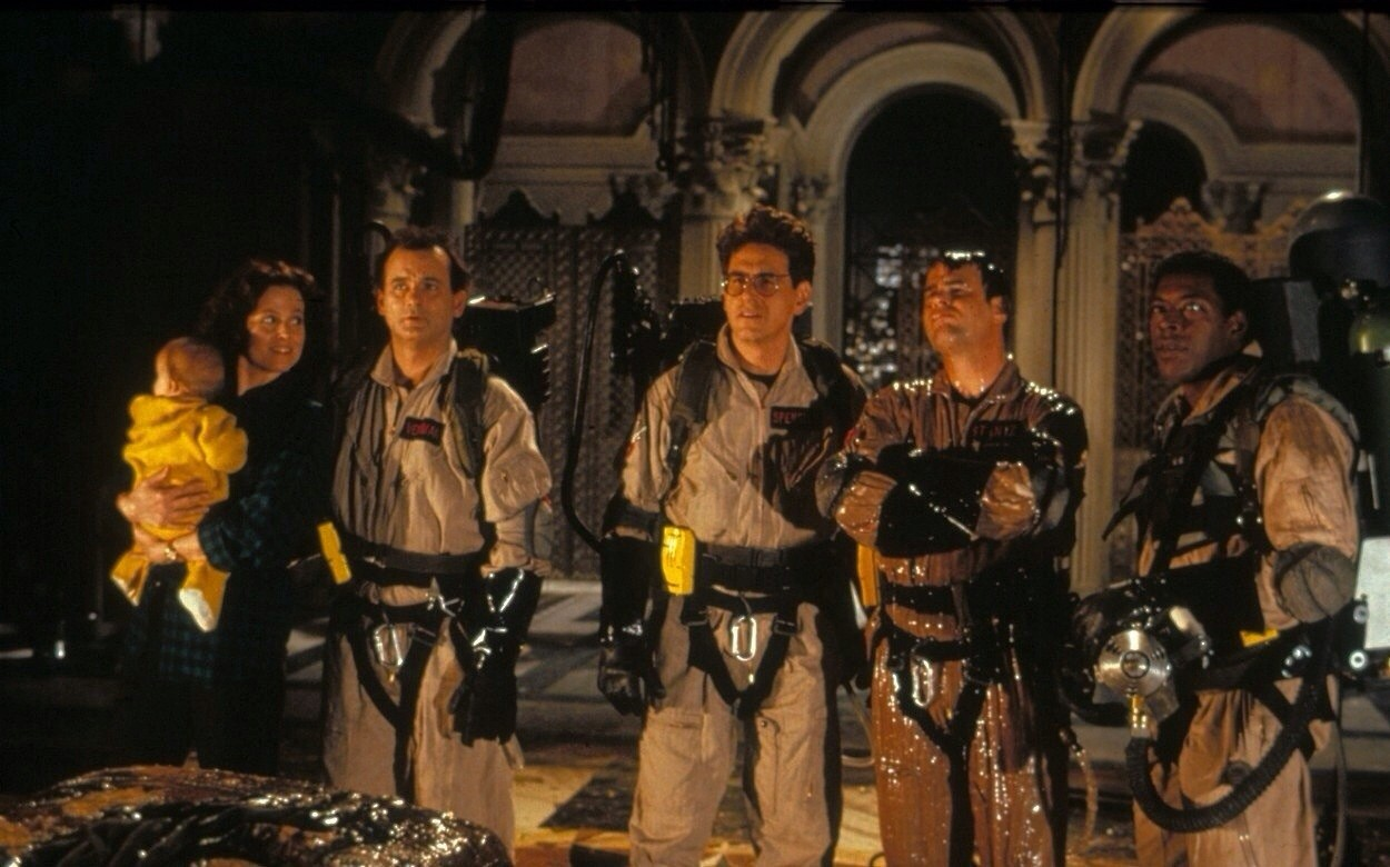 The Ghostbusters back in action - (l to r) Sigourney Weaver (with baby), Bill Murray, Harold Ramis, Dan Aykroyd and Ernie Hudson in Ghostbusters II (1989)