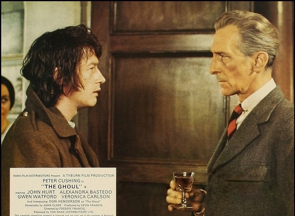 (l to r) A young John Hurt as Tom Rawlings and Peter Cushing as Dr Lawrence in The Ghoul (1975)