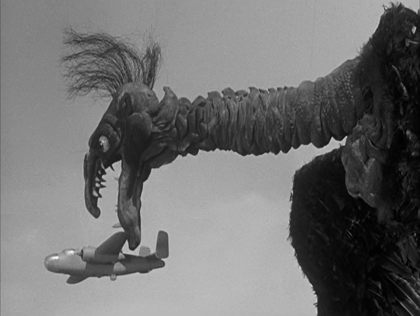 The giant alien bird attacks a plane in The Giant Claw (1957) - perhaps the most pathetic and ridiculous monster in the history of the monster movie
