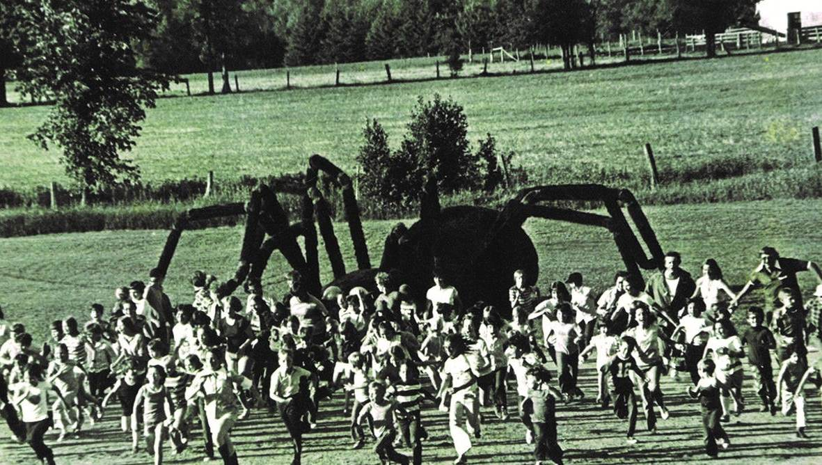 Crowds flee from the giant rampaging Volkswagen spider in The Giant Spider Invasion (1975)
