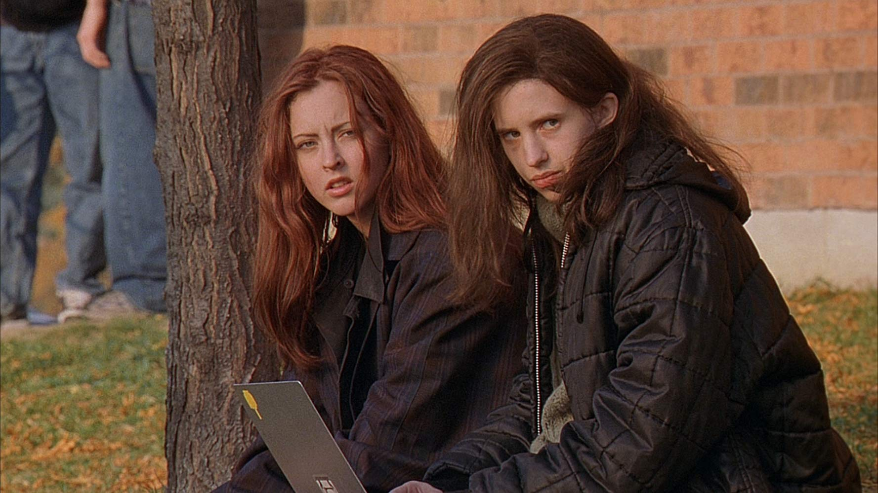 The Fitzgerald sisters - Ginger (Katharine Isabelle) and Bea (Emily Perkins) in Ginger Snaps (2000)