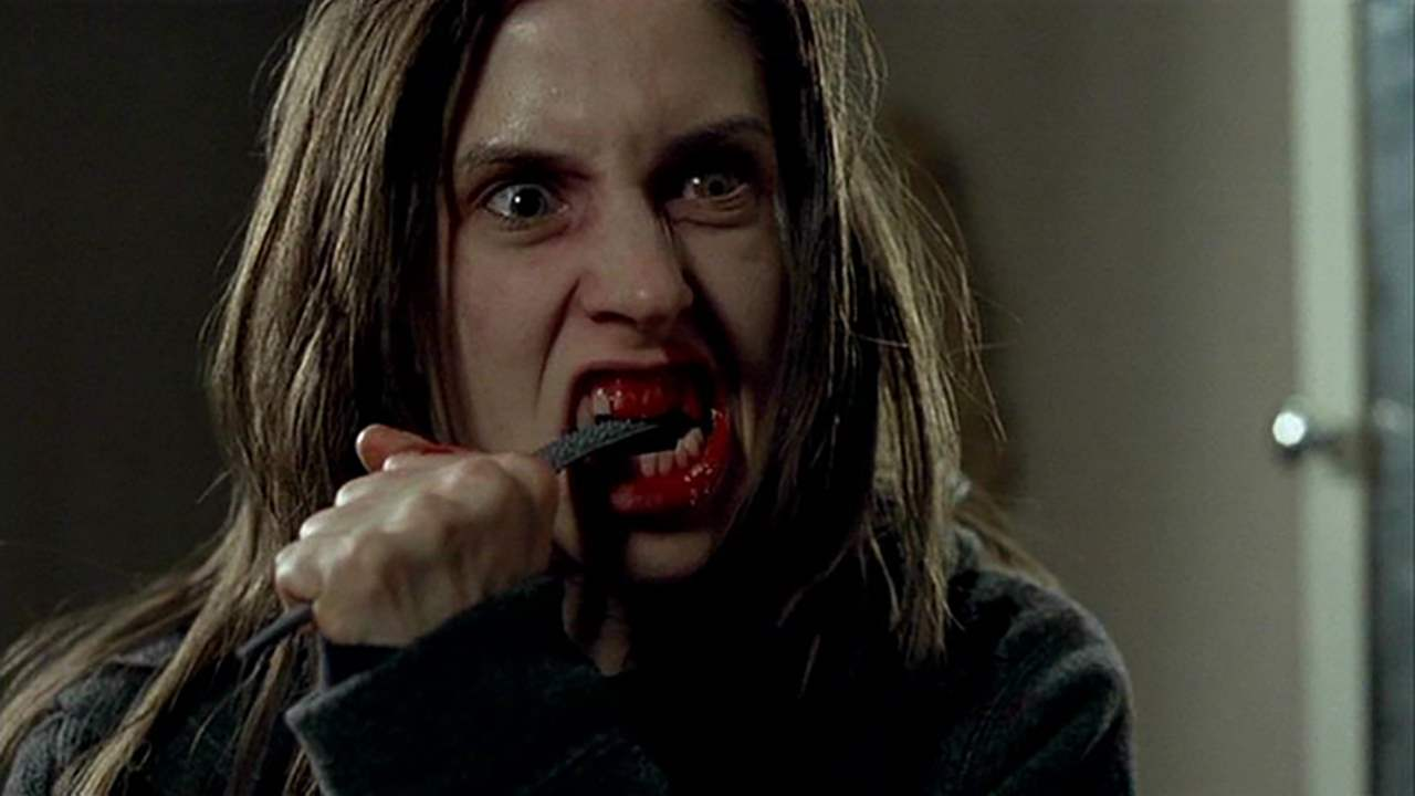 Emily Perkins tries to stop the emergence of the werewolf by filing her teeth down in Ginger Snaps: Unleashed (2004)