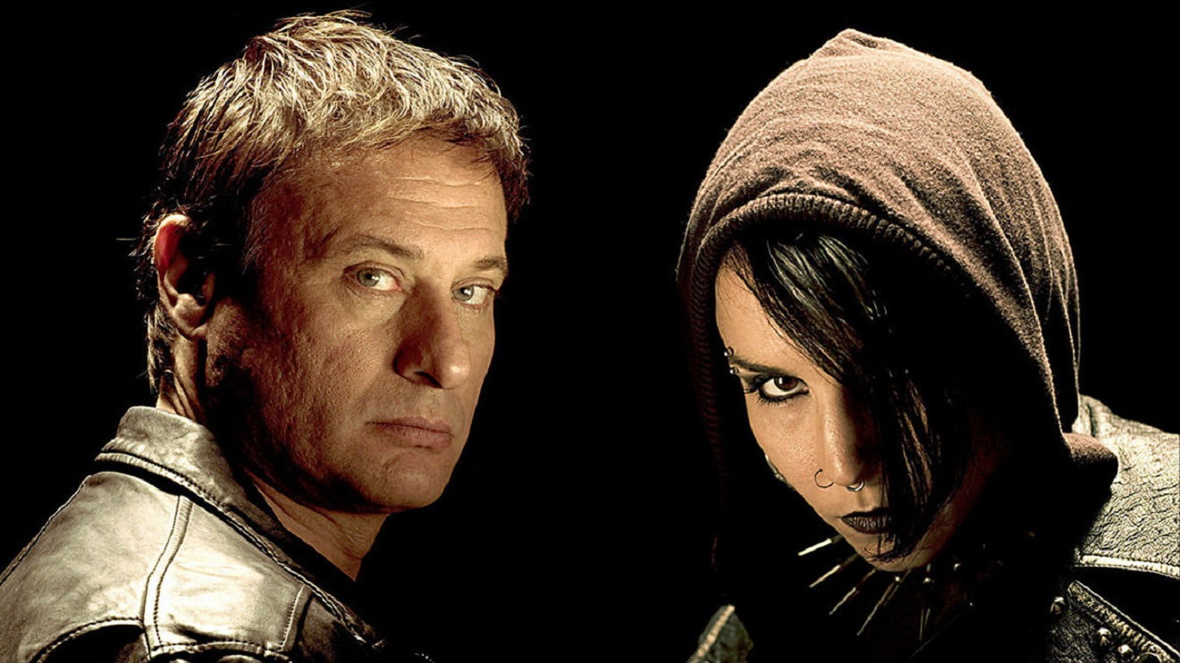 The protagonists of the Millennium trilogy - Michael Nyqvist as Mikael Blomkvist, editor of Millennium magazine, and Noomi Rapace as outlaw hacker Lisbeth Salander in The Girl with the Dragon Tattoo (2009)
