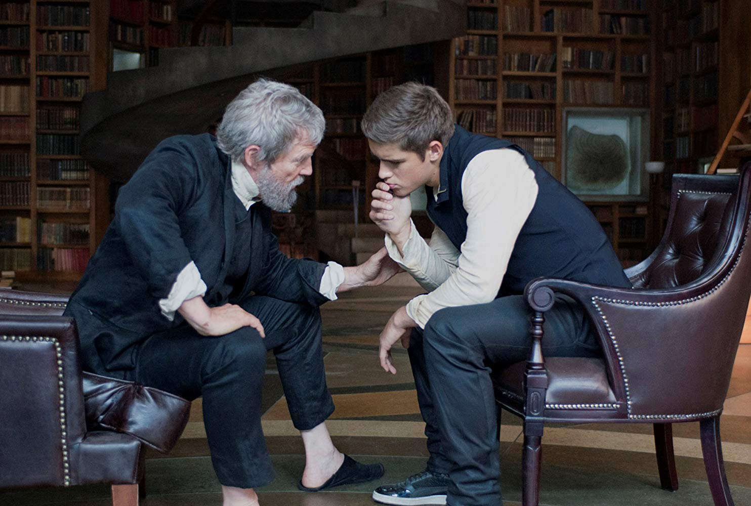 The Giver (Jeff Bridges) instructs Jonas (Brenton Thwaites) in the ways of the past in The Giver (2014)