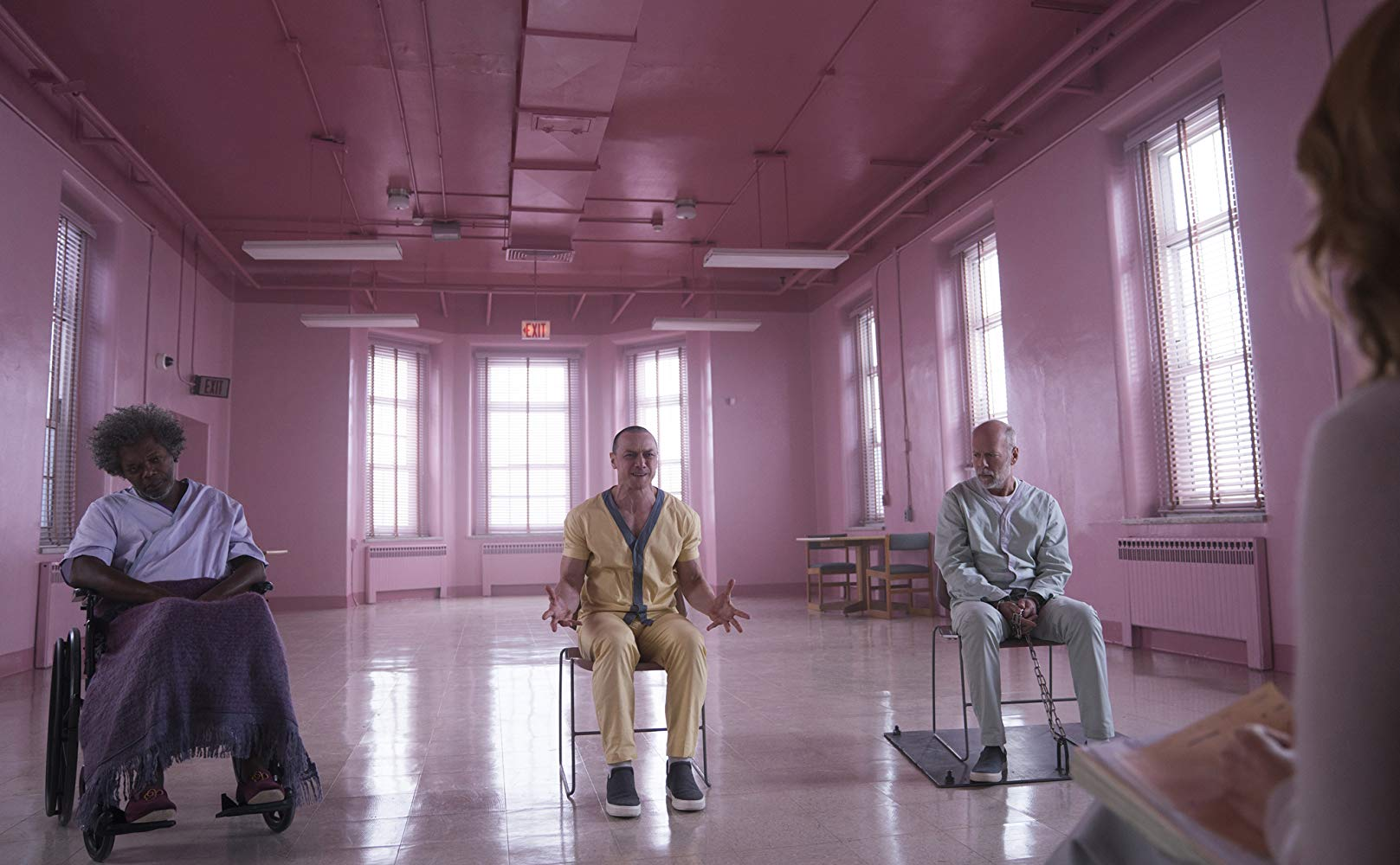 The characters incarcerated in an asylum - (l to r) Elijah Price (Samuel L. Jackson), Kevin Crumb (James McAvoy) and David Dunn (Bruce Willis) in Glass (2019)