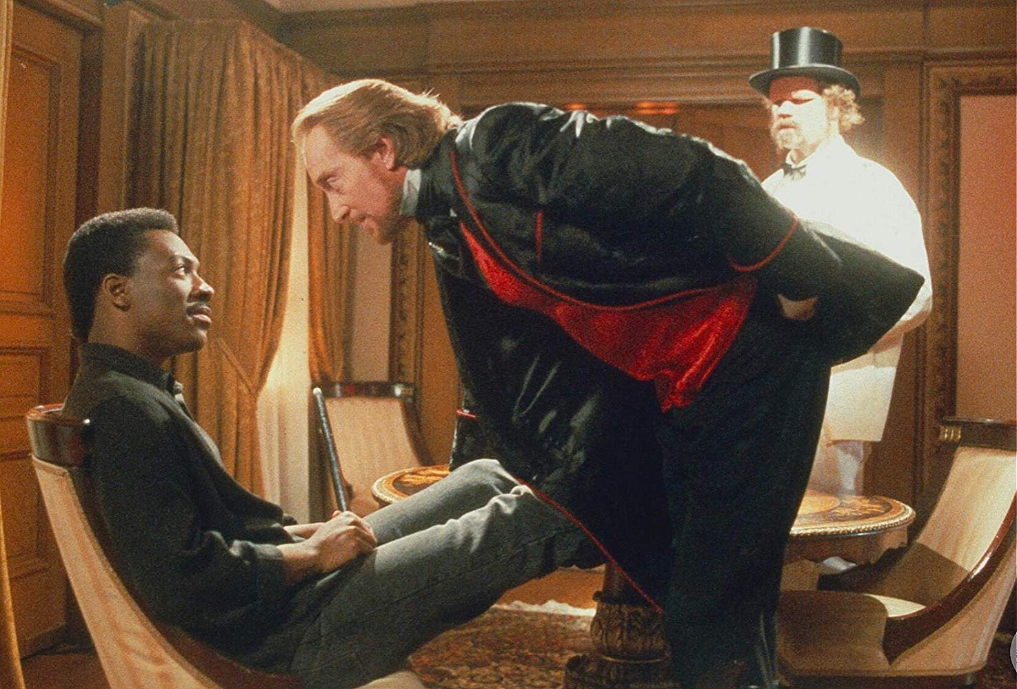 (l to r) Eddie Murphy with Charles Dance as the demonic Sardo Numspa in The Golden Child (1986)