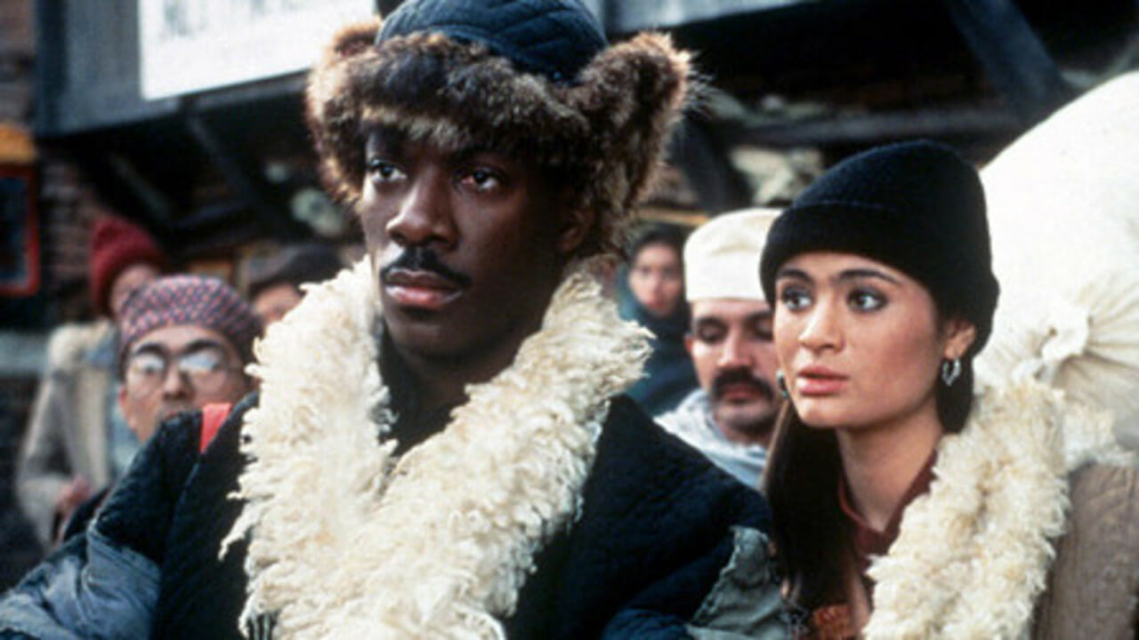 Edde Murphy as social worker Chandler Jarrell and Charlotte Lewis as the Tibetan envoy in The Golden Child (1986)