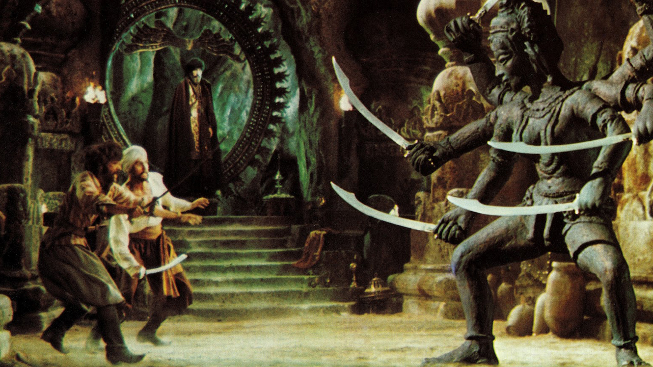 Sinbad (John Philip Law) and men fight the statue of Kali brought to life by the sorcerer Koura (Tom Baker) in The Golden Voyage of Sinbad (1973)