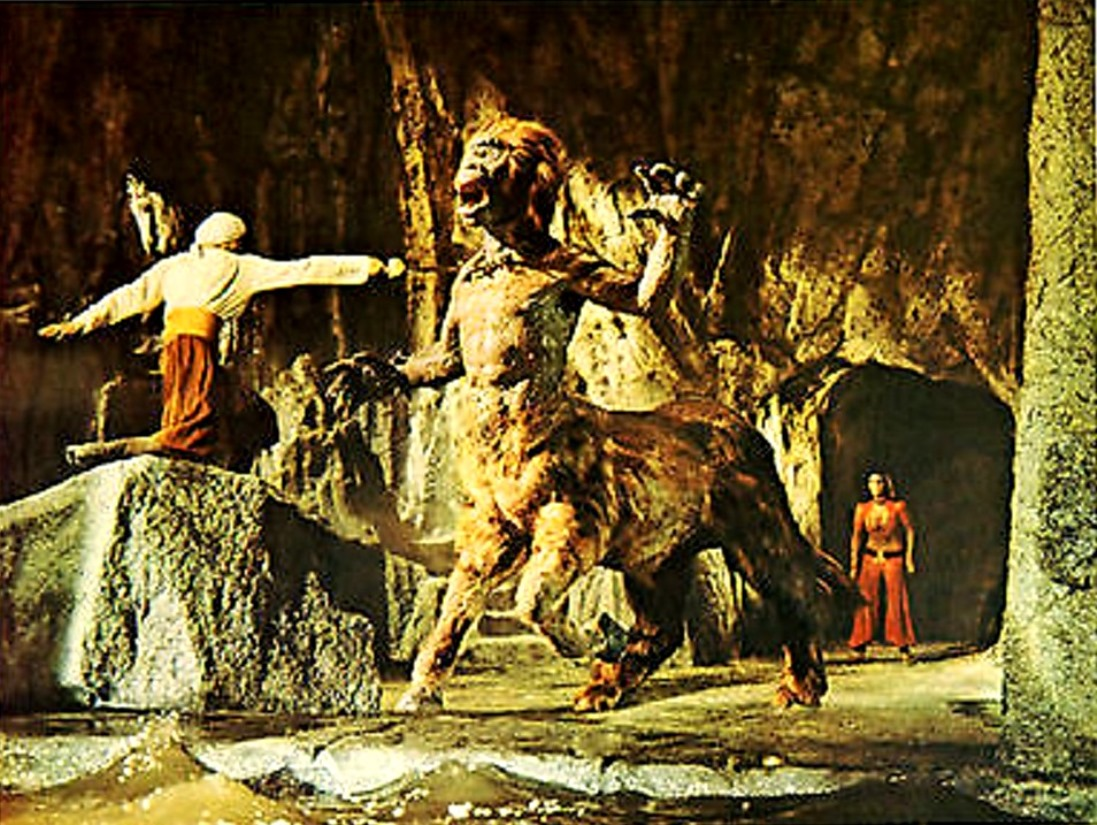 Sinbad (John Philip law) fights the centaur while Margiana (Caroline Munro) stands in the background in The Golden Voyage of Sinbad (1973)
