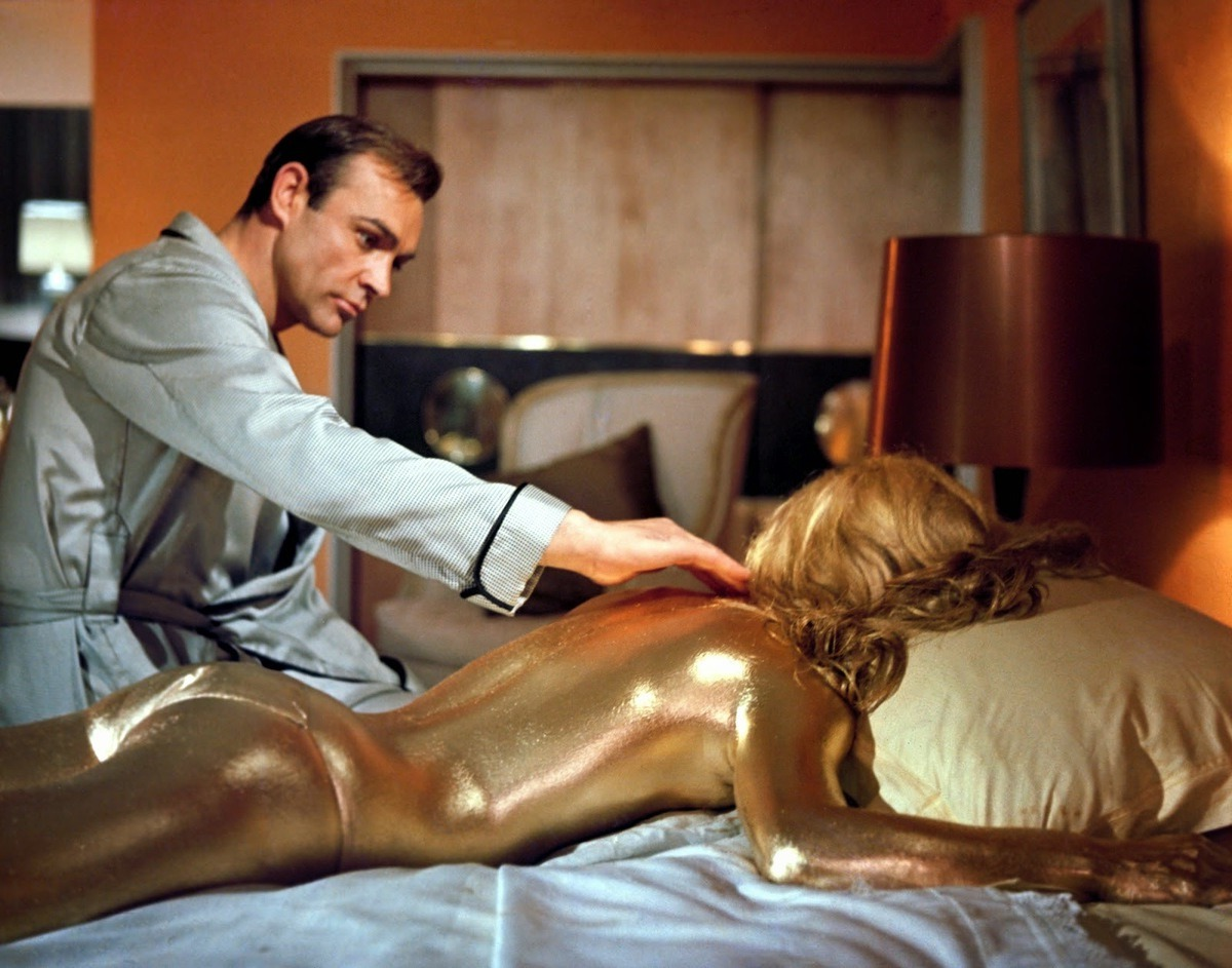 James Bond (Sean Connery) finds Shirley Eaton spray-painted with gold in Goldfinger (1964)