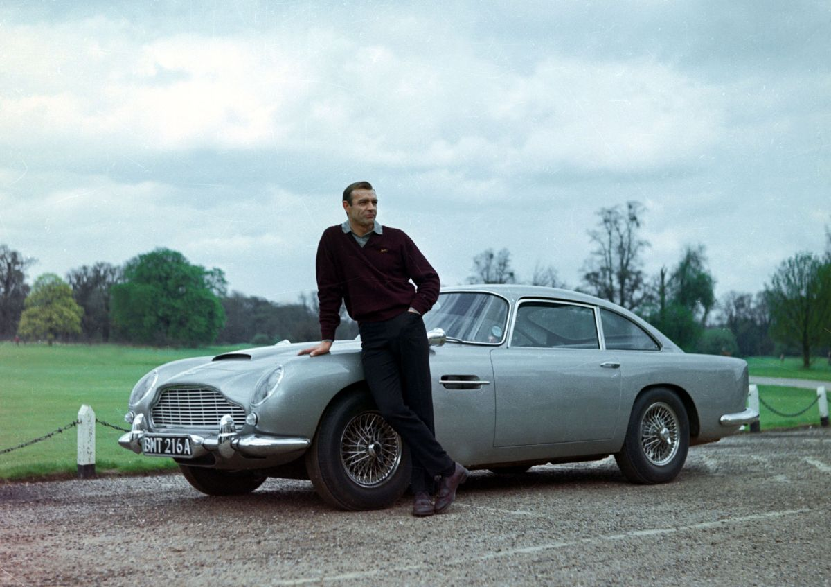 Sean Connery as James Bond with the classic Bond car The Aston Martin DB5 in Goldfinger (1964)