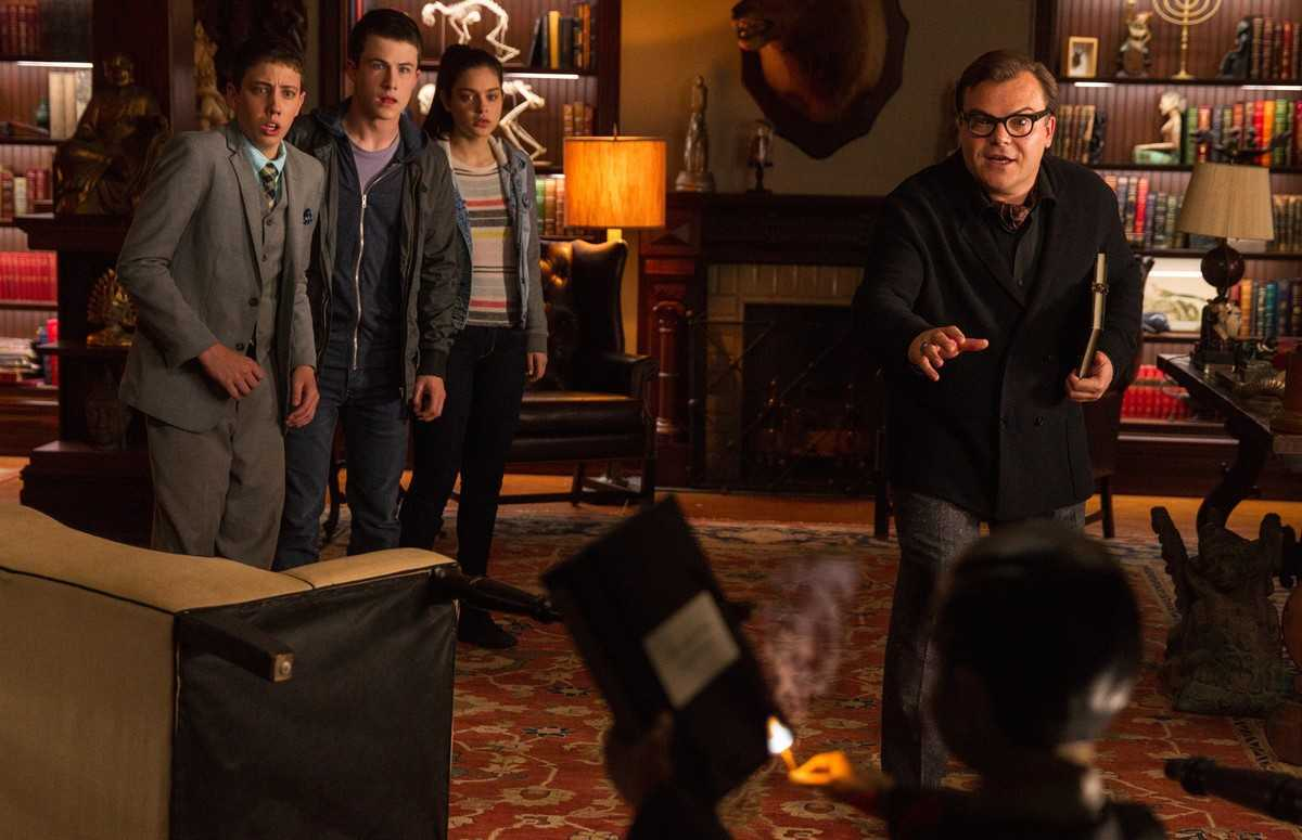 Ryan Lee, Dylan Minette, Odeya Rush and Jack Black face Slappy as he threatens to destroy the books in Goosebumps (2015)