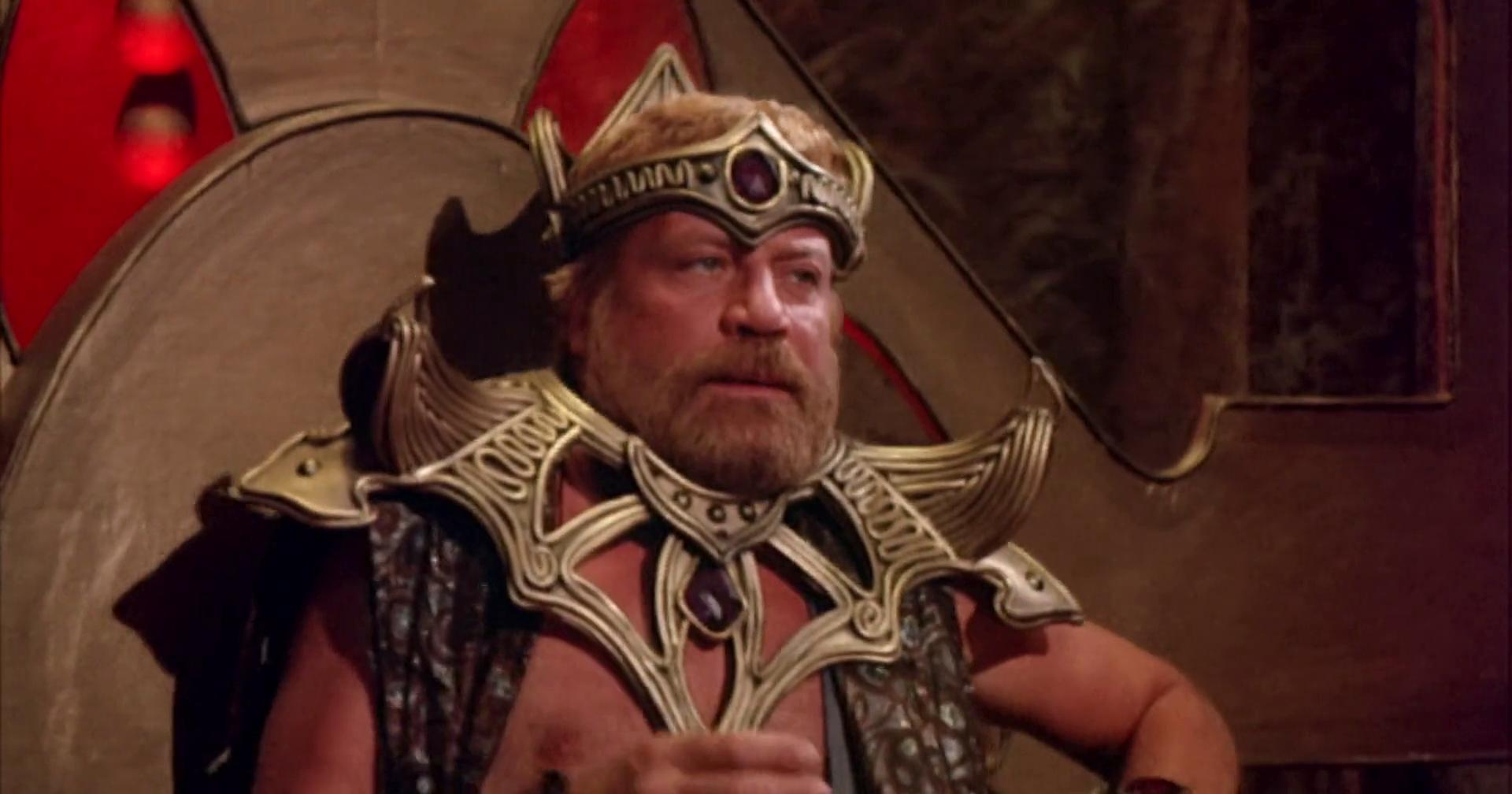 Oliver Reed as the warlord Sarm in Gor (1987)