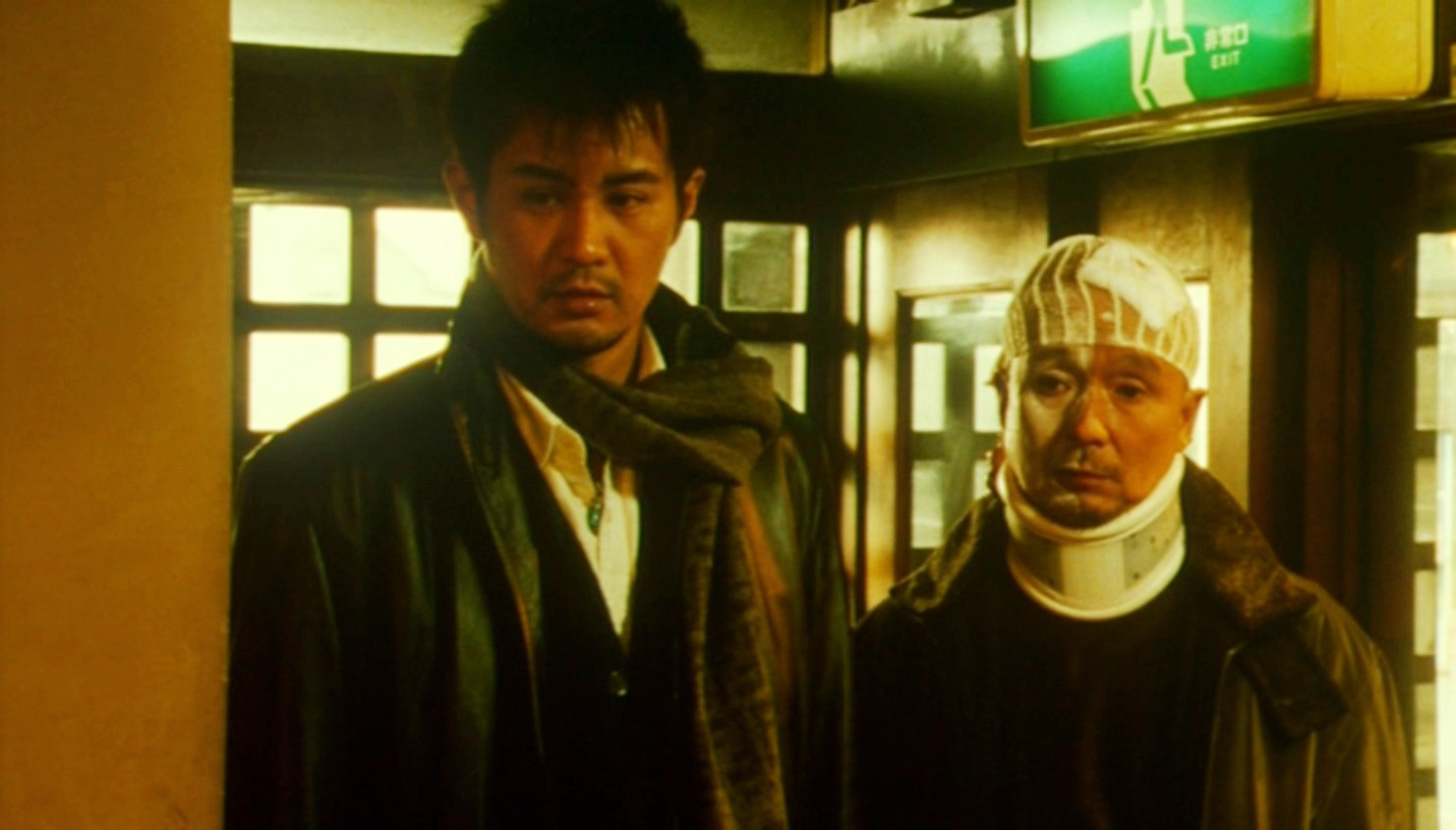 (l to r) Hideki Sone on a quest for his missing brother and Harumi Sone as the battered medium in Gozu (2003)
