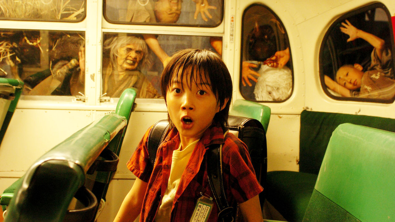 Young Tadashi (Ryuunosuke Kamiki) surrounded by Yokai creatures in The Great Yokai War (2005)