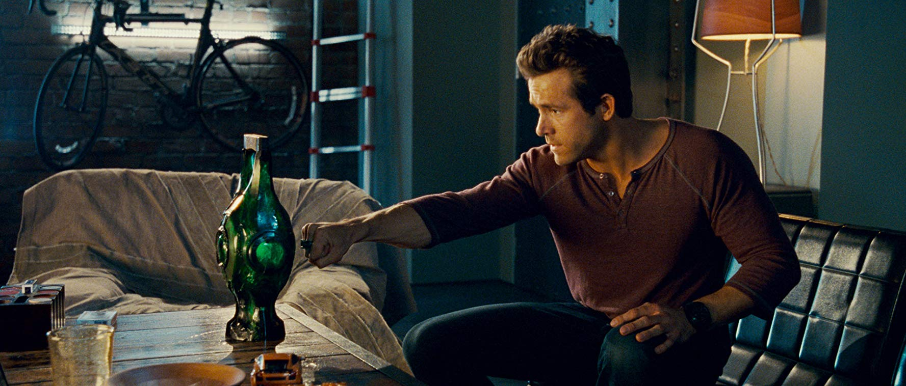 Hal Jordan (Ryan Reynolds) places his ring to the Green Lantern