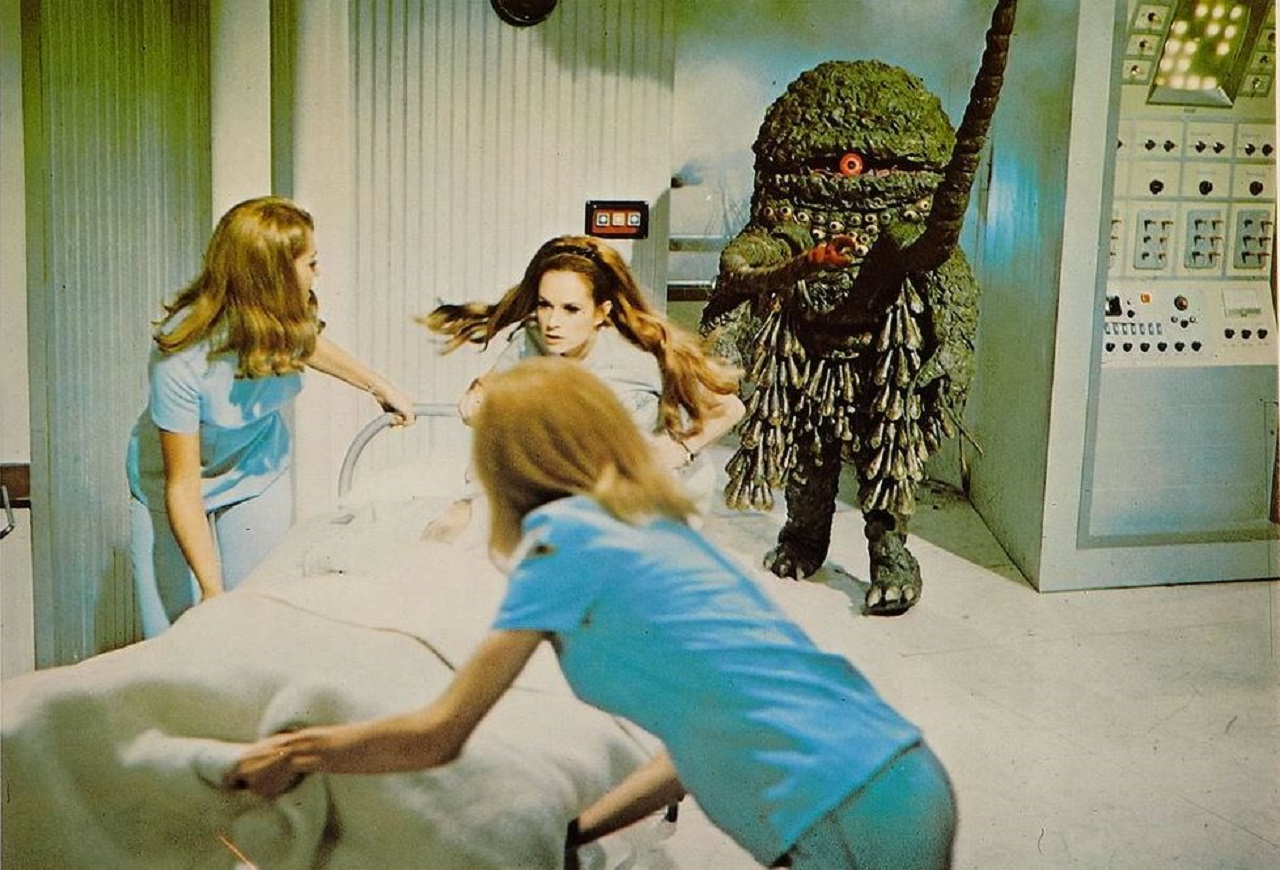 The alien invades the space station as the medical staf flee. With Luciana Paluzzi (c) in The Green Slime (1968)