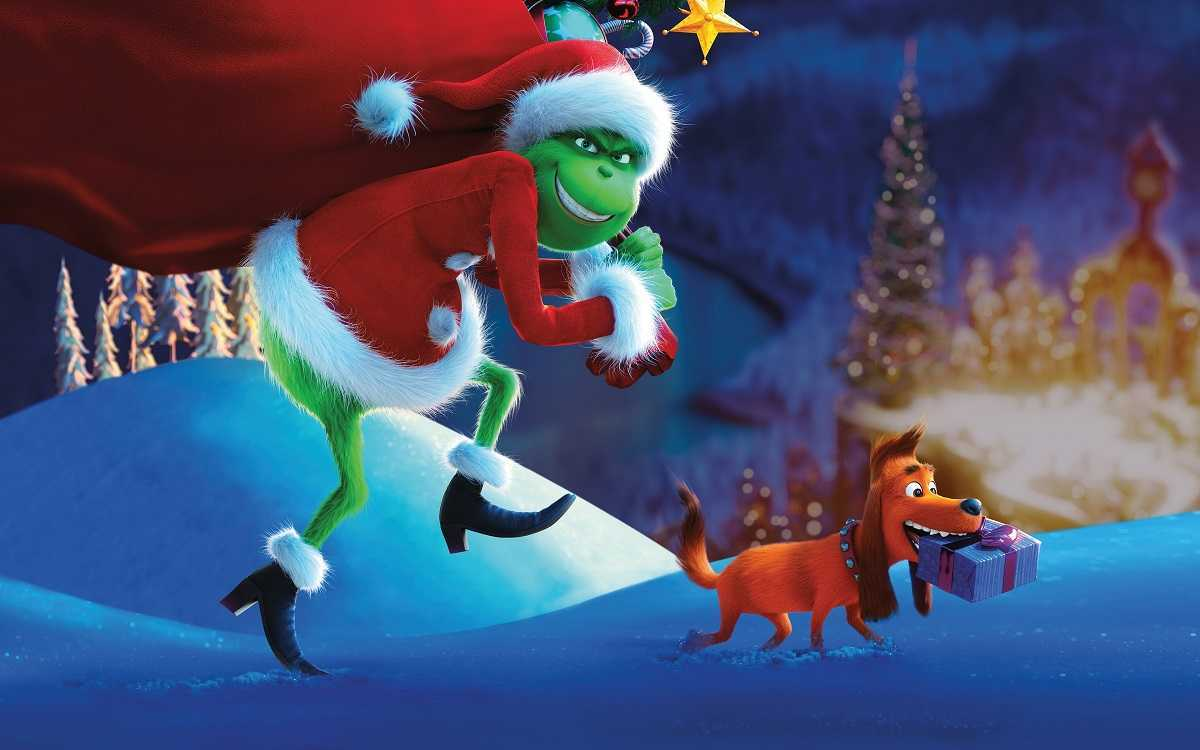 The Grinch accompanied by max steals Christmas from the residents of Whoville in The Grinch (2018)