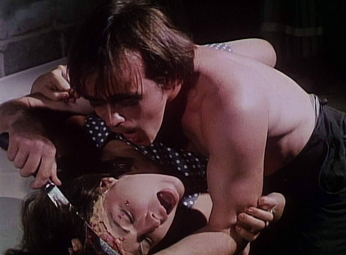 Chris Martell scalps a woman in The Gruesome Twosome (1967)