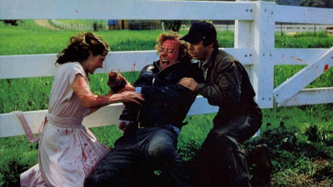 Michael Caine (c) has his hand severed in an accident as Andrea Marcovicci and Bruce McGill try to help in The Hand (1981)