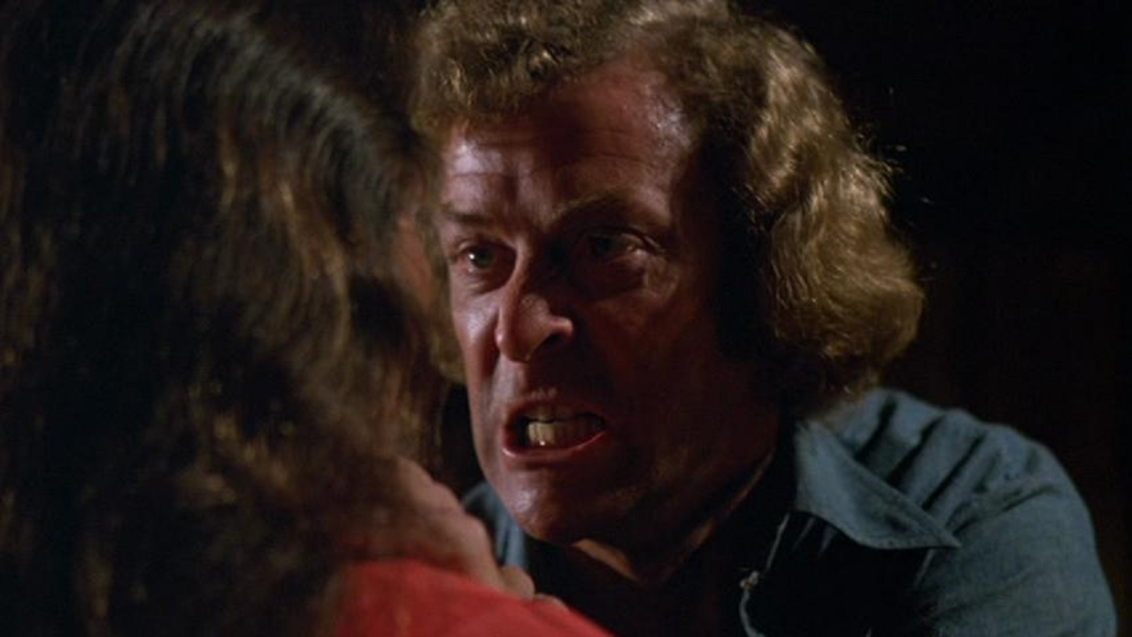 A maddened Jonathan Lansdale (Michael Caine) threatens girlfriend Andrea Marcovicci in The Hand (1981)