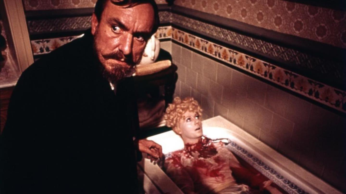 Eric Porter discovers a murdered body in the bath in Hands of the Ripper (1971)