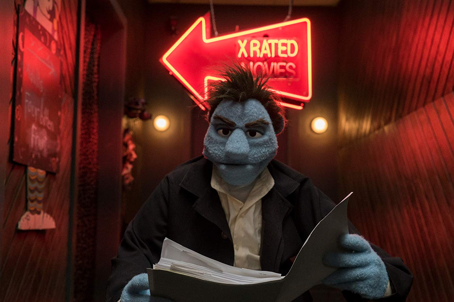 Phil investigates clues at a puppet porn store in The Happytime Murders (2018)