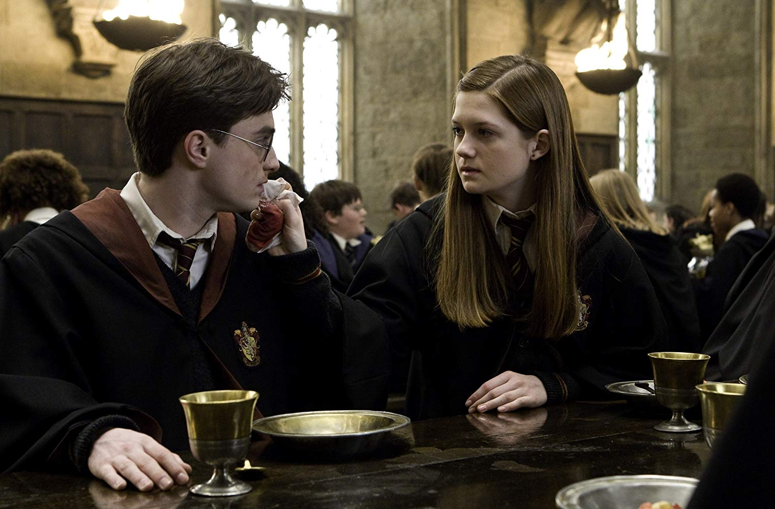 Growing attraction between Harry Potter (Daniel Radcliffe) and Ginny Weasley (Bonnie Wright) in Harry Potter and the Half-Blood Prince (2009)