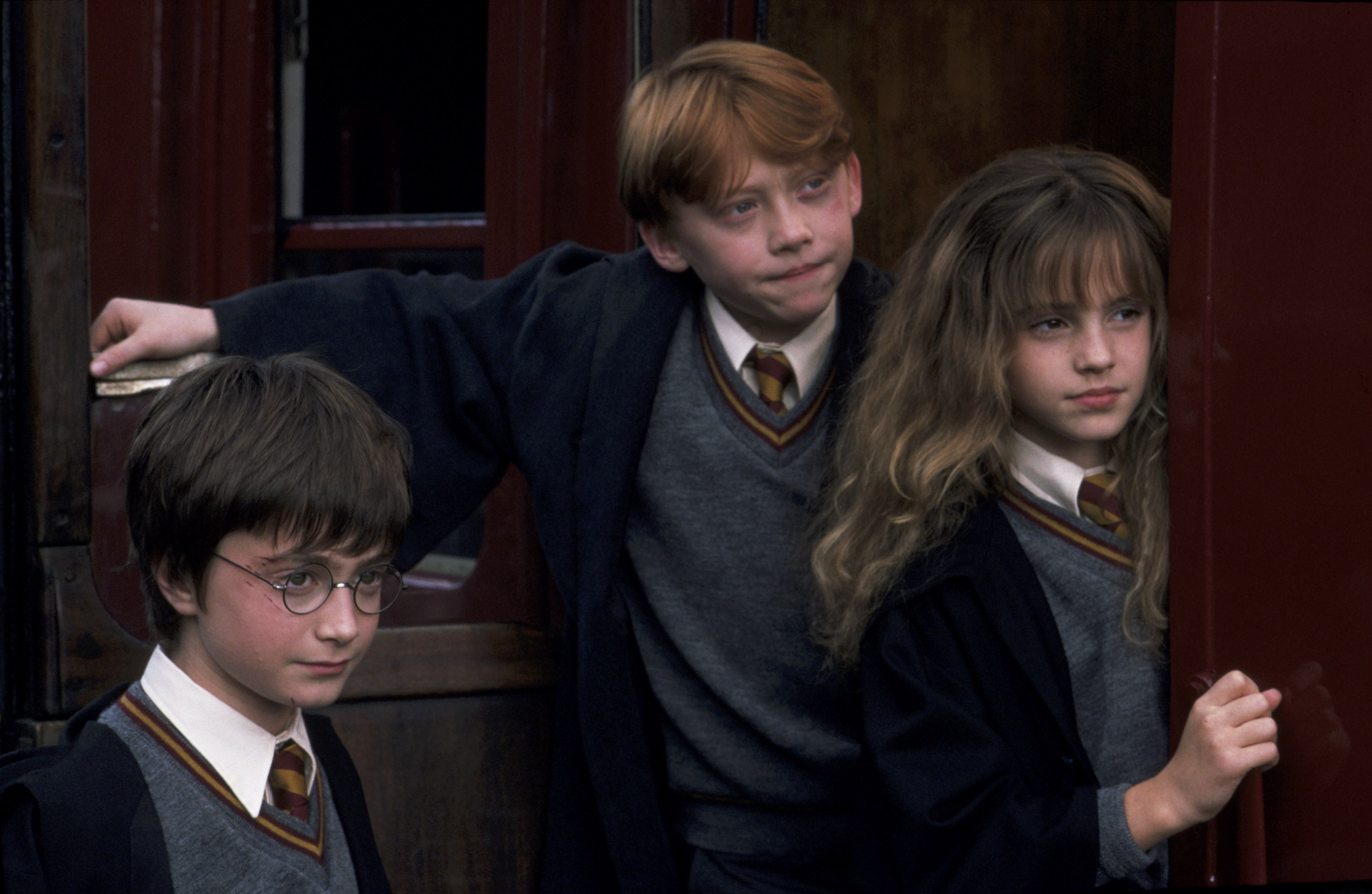 Harry Potter (Daniel Radcliffe), Ron Weasley (Rupert Grint) and Hermione Granger (Emma Watson) in Harry Potter and the Sorcerer's Stone (2001)