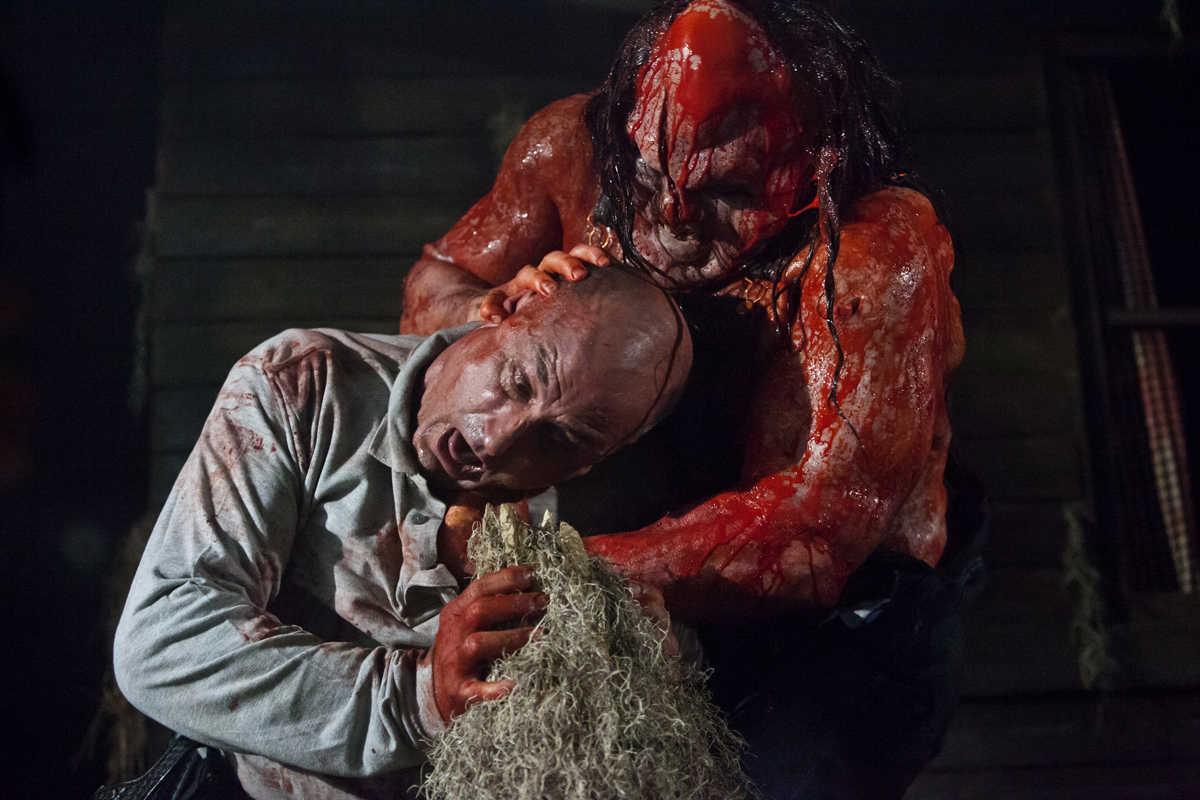 Kane Hodder as the resurrected Victor Crowley attacks Derek Mears in Hatchet III (2013)