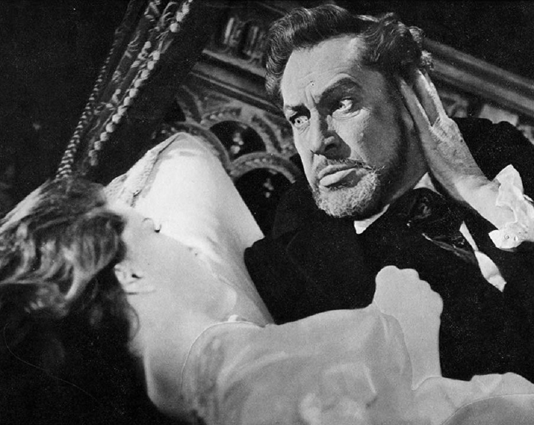 A possessed Charles Dexter Ward (Vincent Price) menaces Debra Paget in The Haunted Palace (1963)