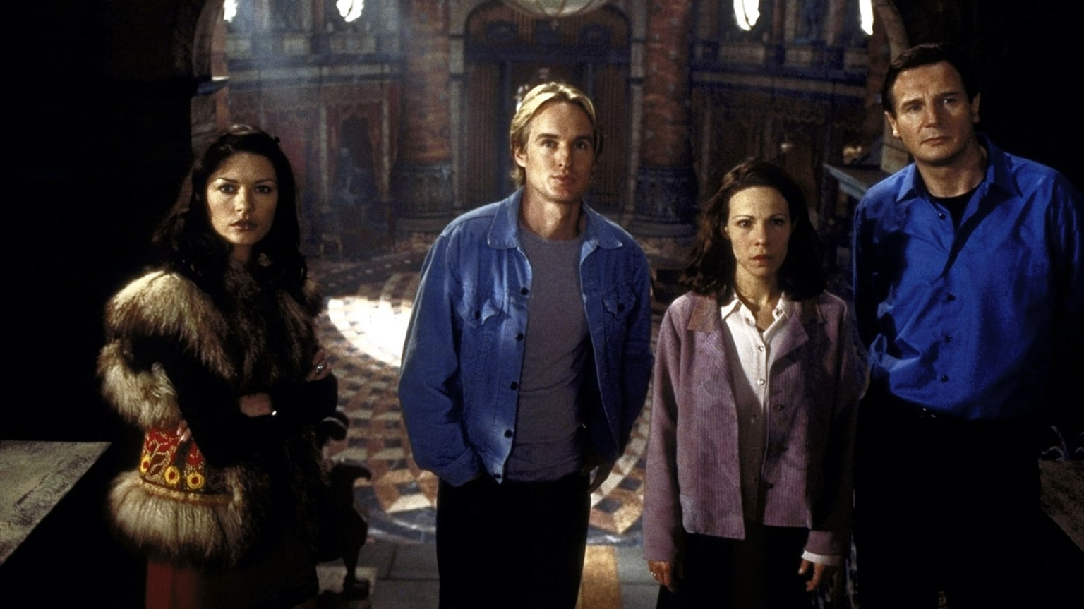The investigatory team - Theo (Catherine Zeta-Jones), Luke Sanderson (Owen Wilson), Eleanor Vance (Lili Taylor) and Dr David Merrow (Liam Neeson) in The Haunting (1999)
