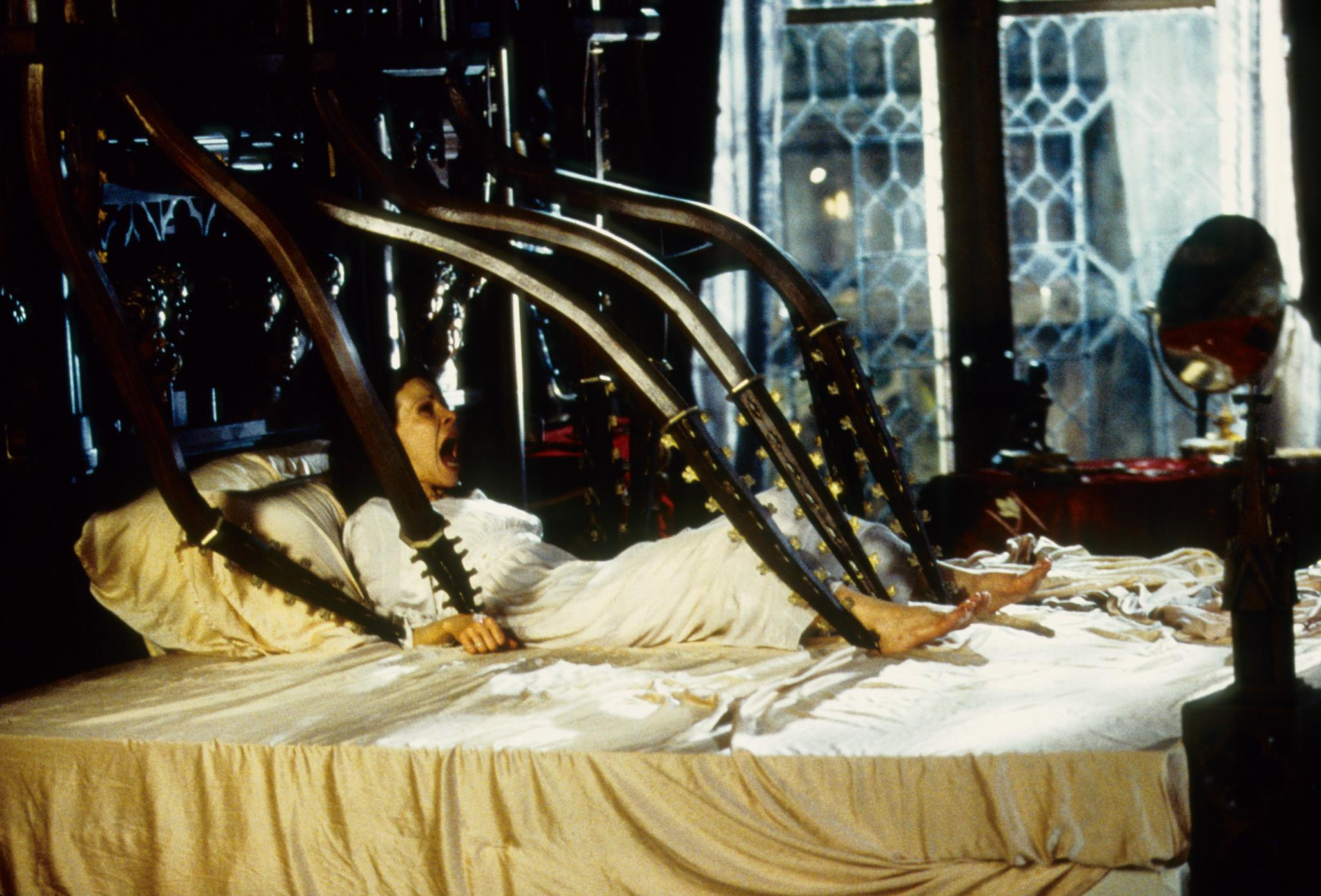 Lili Taylor attacked by a wrought iron bed in The Haunting (1999)