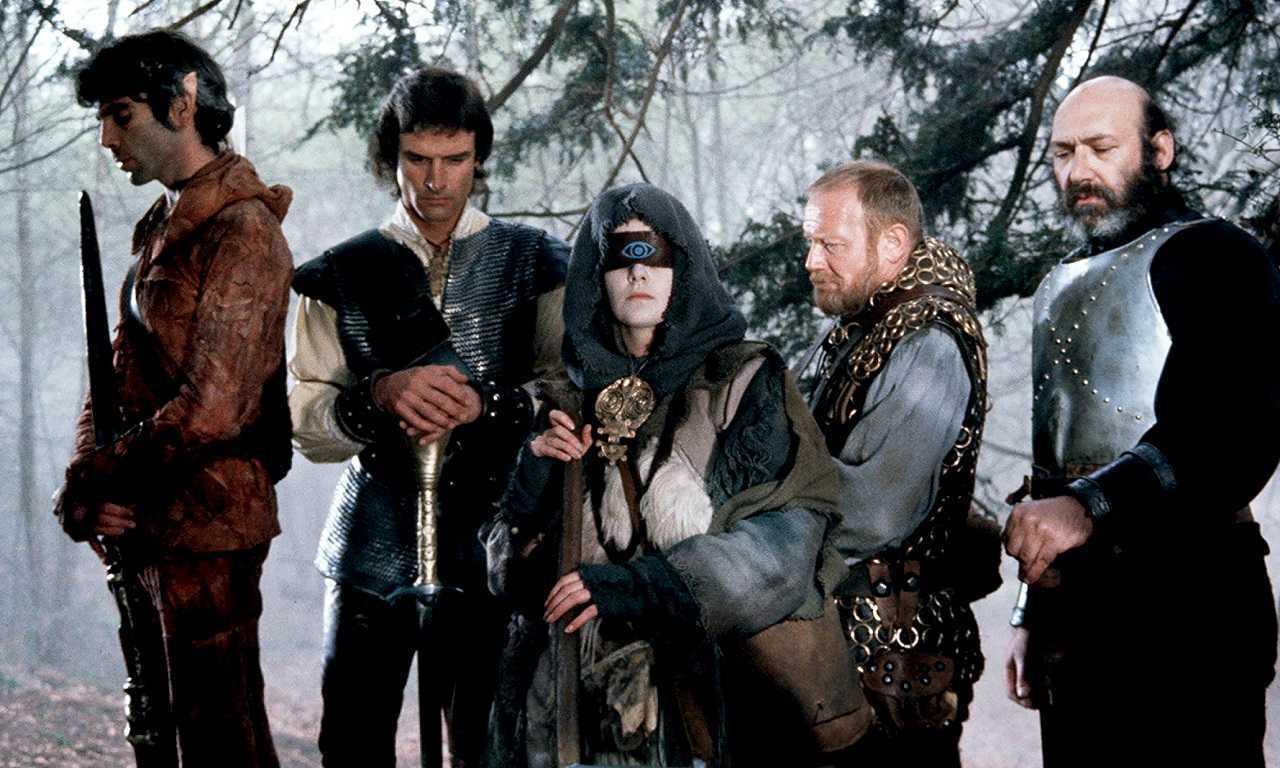 Crow (Ray Charleson), Hawk (John Terry), The Witch Woman (Patricia Quinn), Ranulf (Morgan Sheppard) and Gort (Bernard Bresslaw) in Hawk the Slayer (1980)