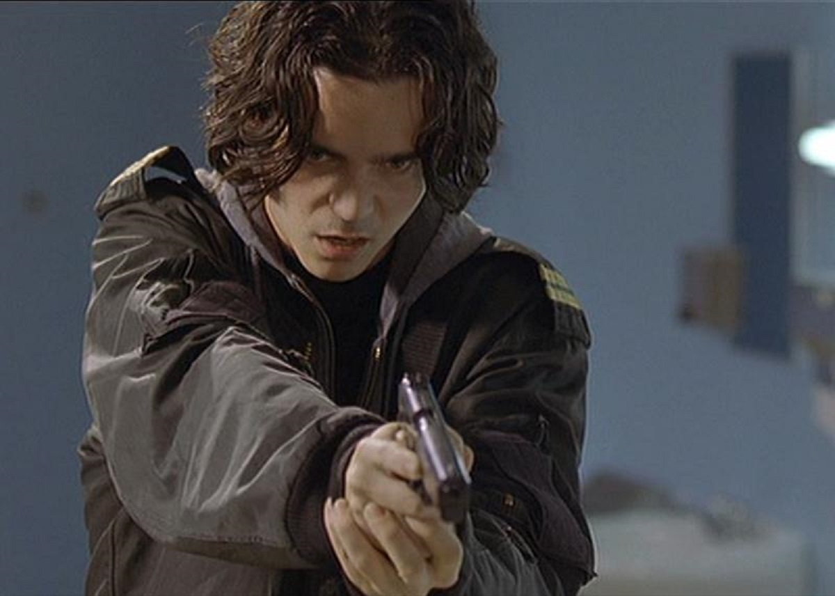 Kett Turton wields gun in Heart of America: Home Room (2002)