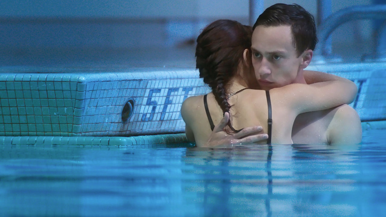 Aubrey Peeples and Keir Gilchrist embrace in a pool in Heartthrob (2017)