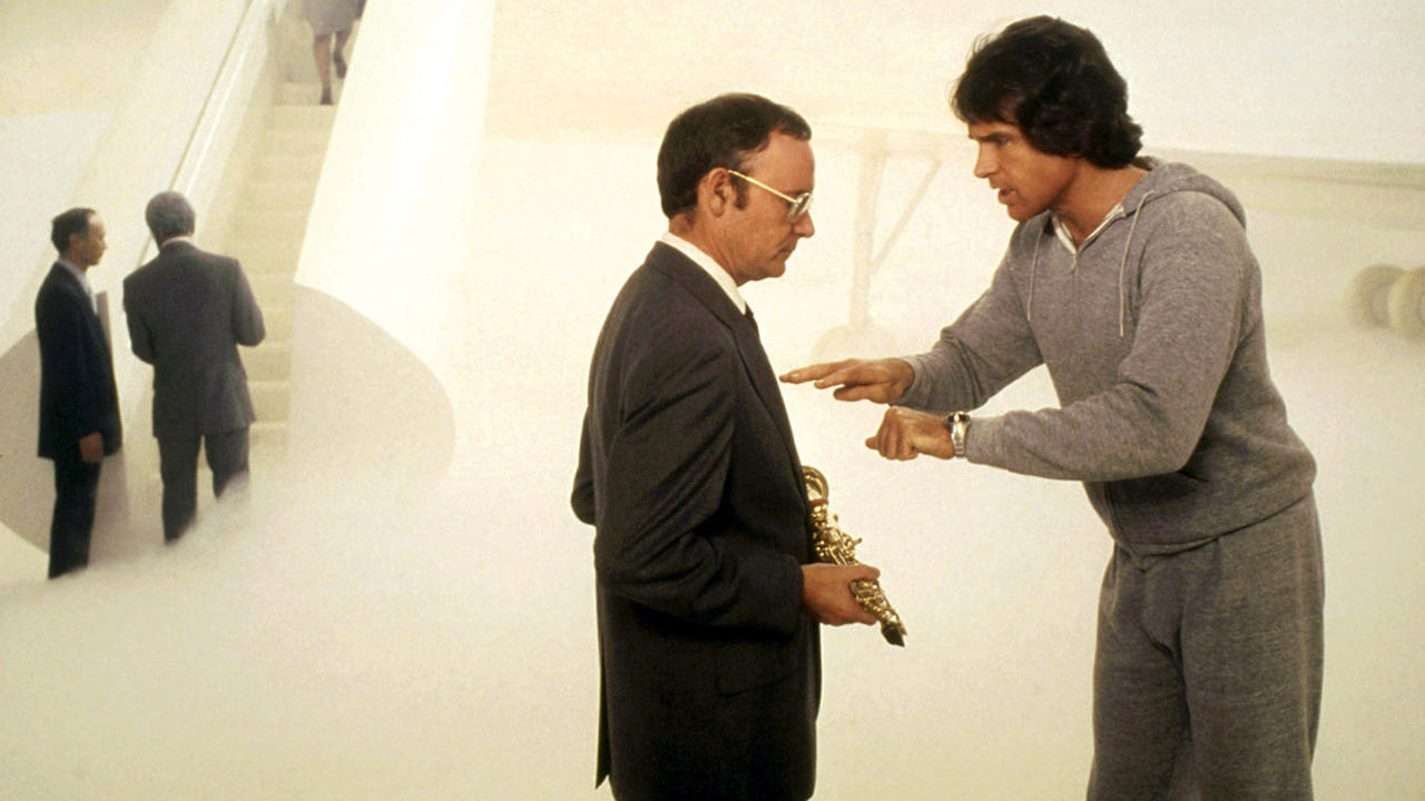 Joe Pendleton (Warren Beatty) argues with The Escort (co-director Buck Henry) in the afterlife in Heaven Can Wait (1978)