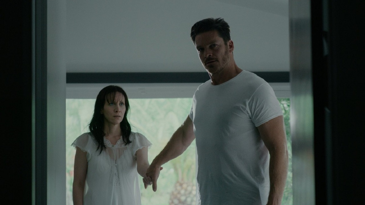 Imprisoned husband and wife Bart Johnson and Jill Awbrey in Held (2020)