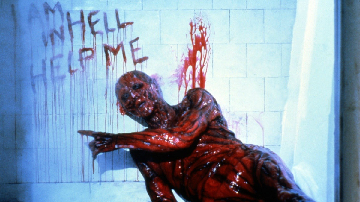 Kristy receives a vision of her father (Oliver Smith) suffering in Hell in Hellbound: Hellraiser II (1988)