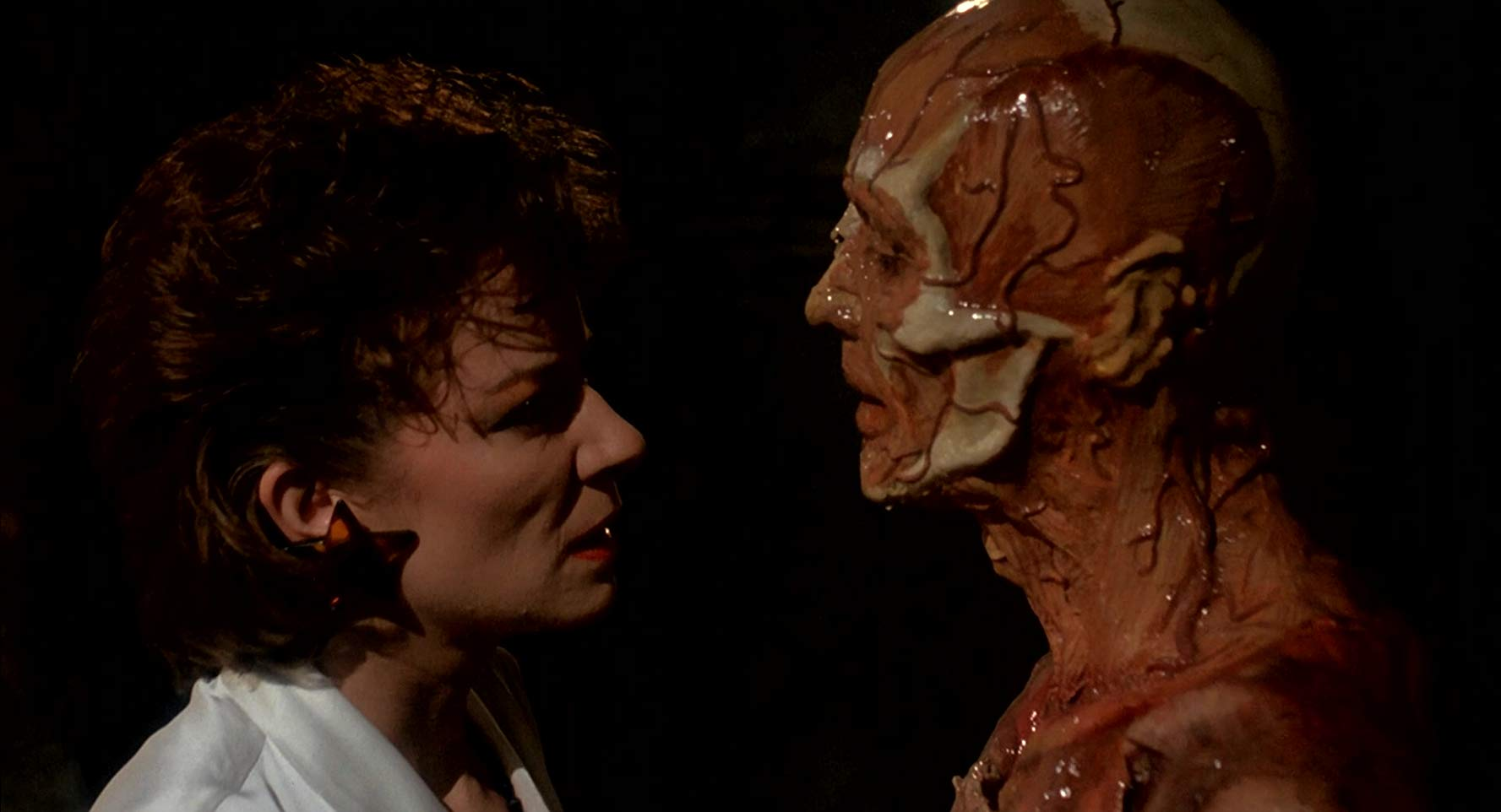 Clare Higgins and the skinless Frank (Oliver Smith) in Hellraiser (1987)