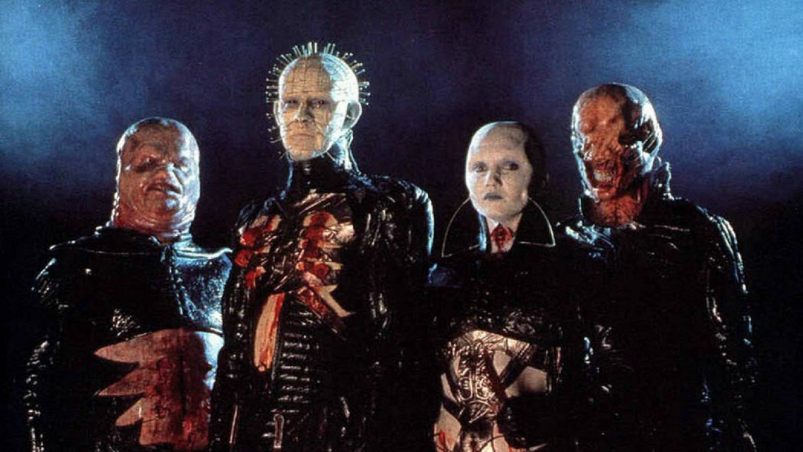 The Cenobites  - Butterball (Simon Bamford), Pinhead (Doug Bradley), the female Cenobite (Grace Kirby) and Chatterer (Nicholas Vince) - in Hellraiser (1987)