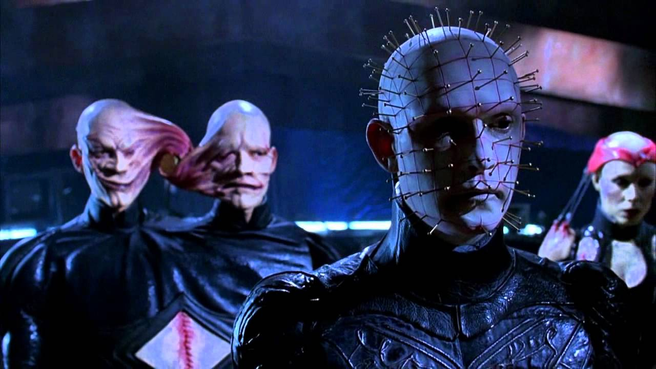 (l to r) The Twins (real-life twins and later directors Mark and Michael Polish), Pinhead (Doug Bradley) and Angelique (Valentina Vargas) in Hellraiser: Bloodline (1996)