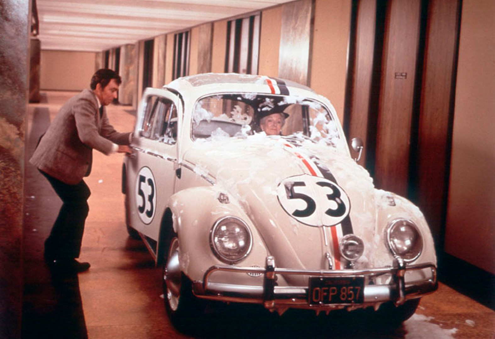Ken Berry joins Helen Hayes as Herbie drives through the hallways of an office building in Herbie Rides Again (1974)