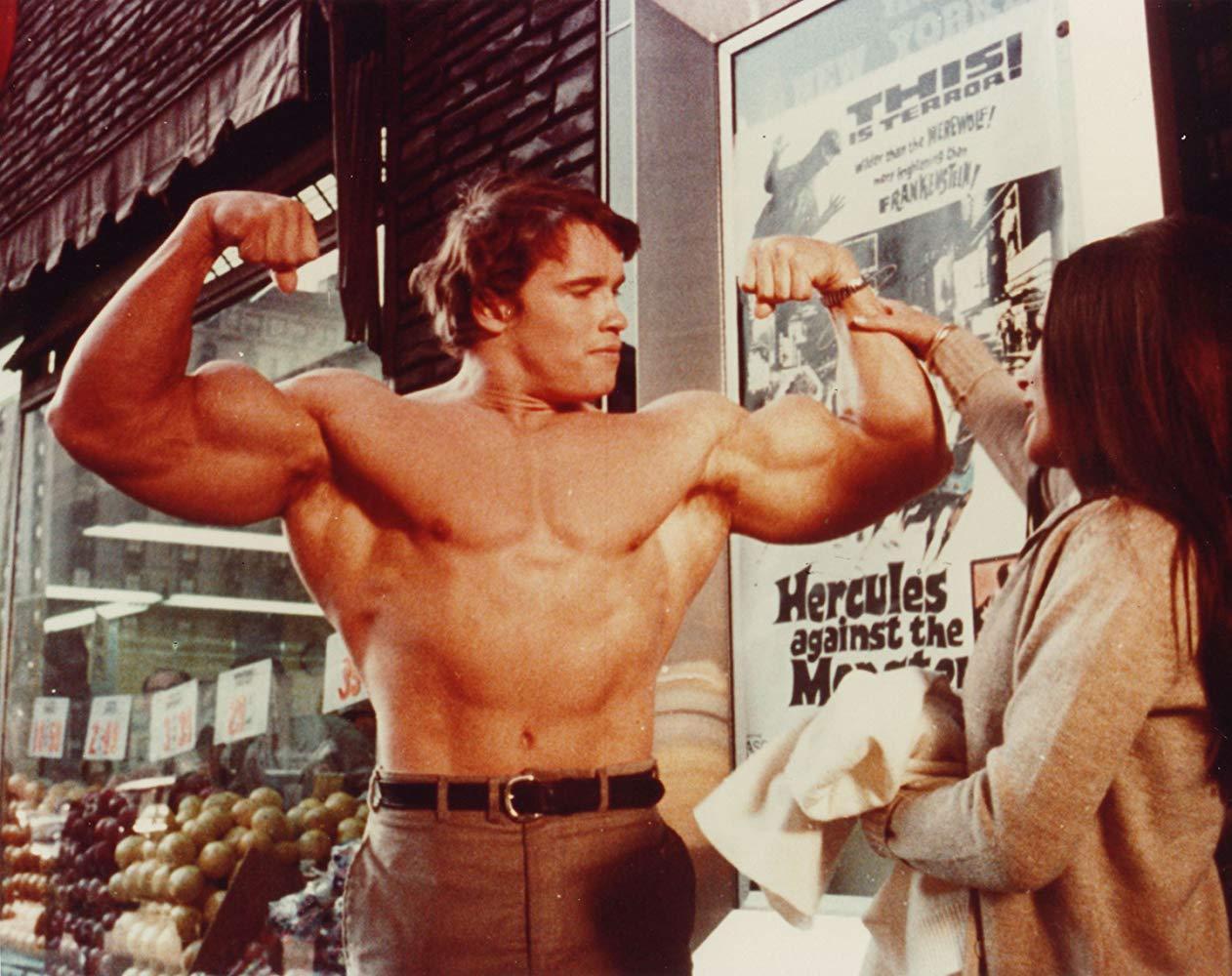 Hercules (Arnold Schwarzenegger) shows off his muscles in Hercules in New York (1970)